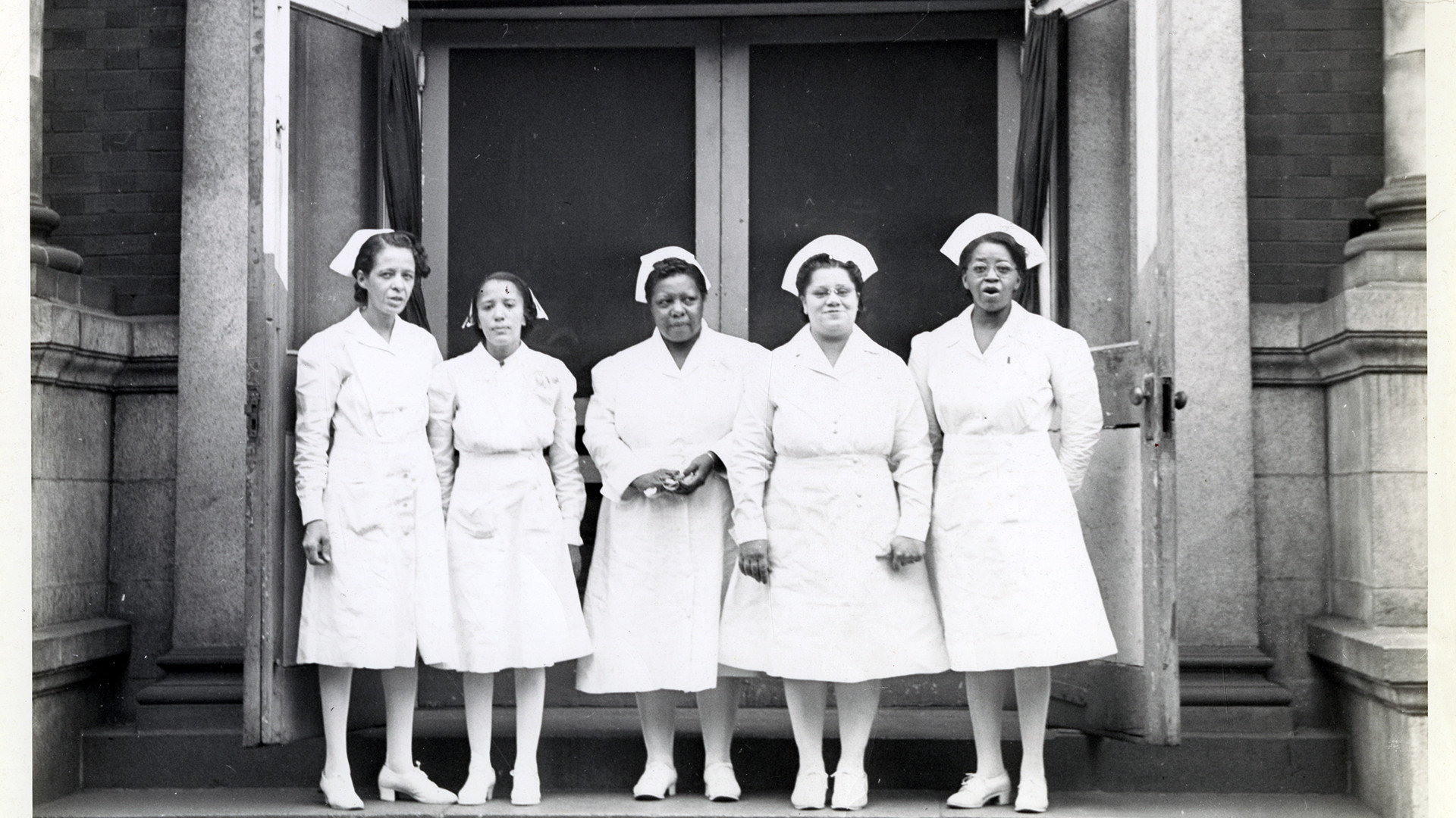 Nurses in front of the Frederick Douglass Memorial Hospital ...