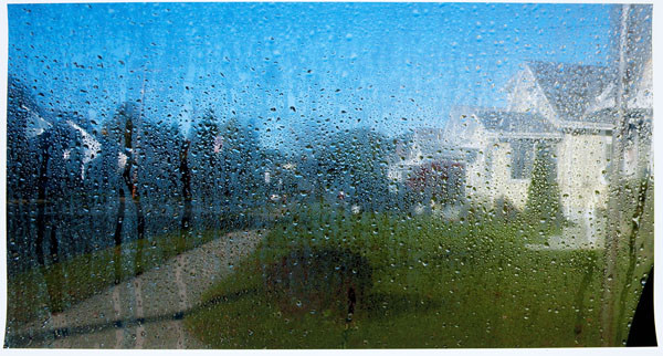 Stuart Shils: Wide View of Suburban Street with Sun Melting Ice on Windshield (2009) Archival pigment print