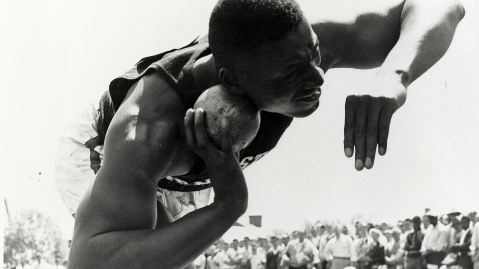 Charles L. Blockson representing the Pennsylvania State University track and field team in the shot put at the Penn Relays, Franklin Field, University of Pennsylvania, Philadelphia