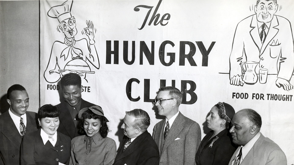 Ruby Dee (fourth from left) and her husband, Ossie Davis (third from left), with unidentified people at the Christian Street YMCA, Philadelphia