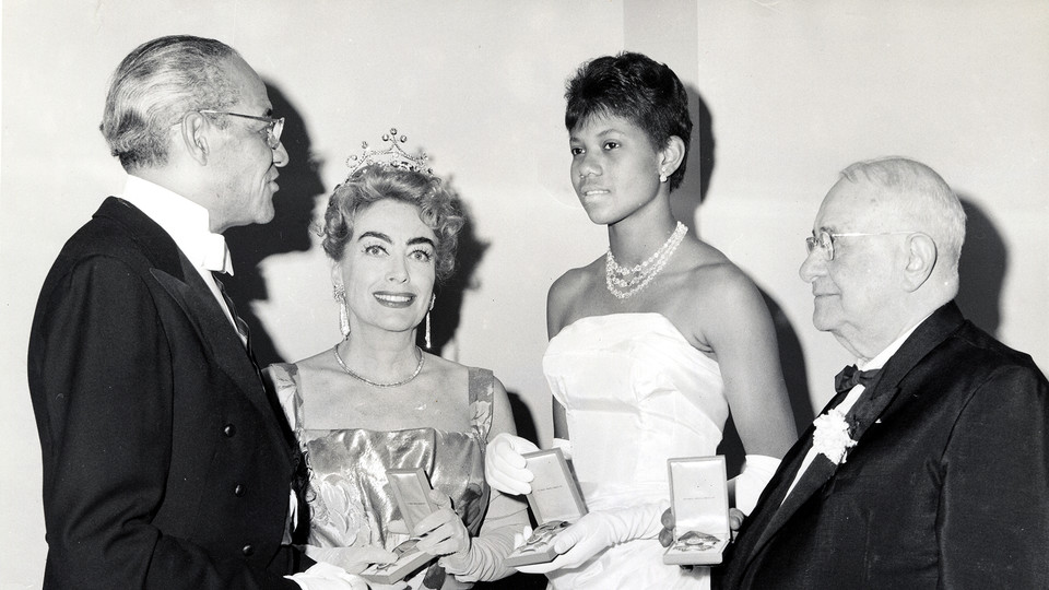 Left to right: Judge Raymond Pace Alexander, Joan Crawford, Wilma Rudolph, and Arthur Spingarn at the 12th Annual Philadelphia Cotillion Society Affair