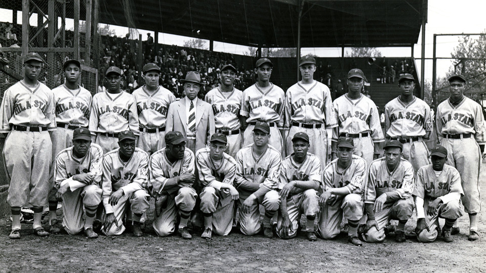 The Philadelphia Stars of the National Negro Baseball League with manager and co-owner Ed Bolden (center).
