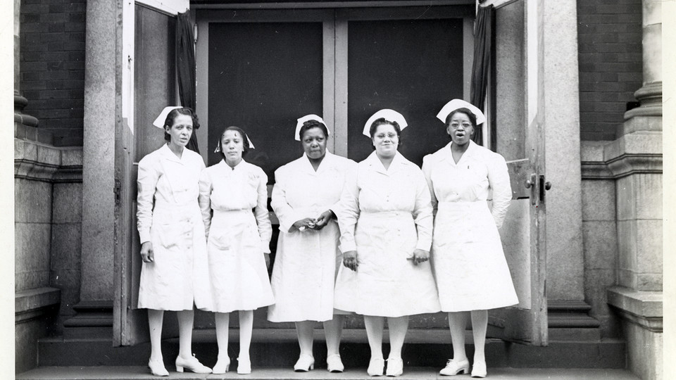 Nurses in front of the Frederick Douglass Memorial Hospital and Training School, 1530–34 Lombard Street, Philadelphia