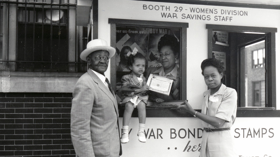 Richard Robert Wright, Sr. and others at a war bond booth